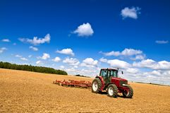 Tractor in plowed field stock images