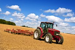 Tractor in plowed field royalty free stock photography