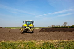 Tractor in a plowed field Stock Image