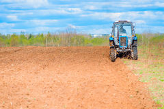 Tractor plowed field Stock Images