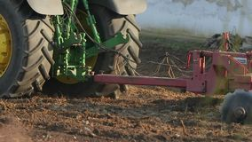Tractor plowing agricultural soil stock video footage
