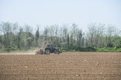 Tractor while plowing Royalty Free Stock Photo