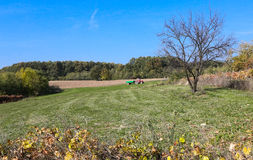 Tractor plowing the big field Stock Photography