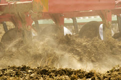 Tractor plowing close-up royalty free stock images