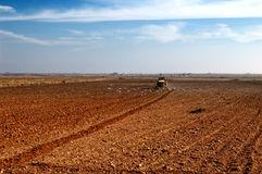 Tractor plowing in the country Stock Photography
