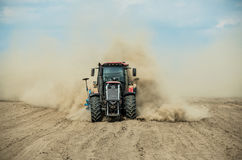Tractor plowing dry farm land at autumn Royalty Free Stock Photo