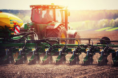 Tractor plowing farm field in preparation for spring planting Royalty Free Stock Image