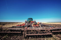Tractor plowing farm field in preparation for spring planting Royalty Free Stock Photography