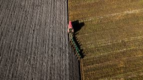 Tractor plowing the field. Aerial shooting. Plowing fields royalty free stock photos