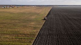 Tractor plowing the field. bird`s eye view royalty free stock photography
