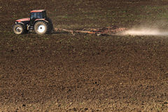Tractor plowing the field. Tractor plowing the plowed field royalty free stock photo