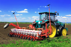 Tractor plowing the field Stock Image