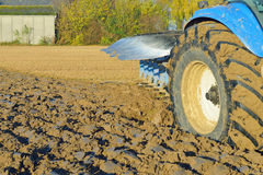 Tractor plowing the field Stock Photos