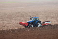 Tractor plowing the field Royalty Free Stock Photography