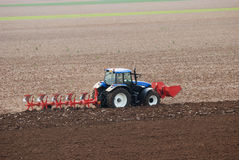 Tractor plowing the field Stock Images