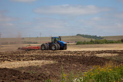 The tractor plowing a field. Royalty Free Stock Image