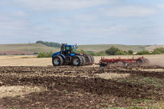 The tractor plowing a field. Royalty Free Stock Images