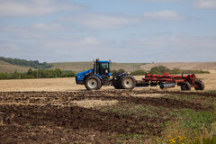 The tractor plowing a field. Stock Photo