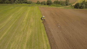 Tractor plowing a field.Aerial video. stock footage