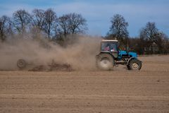Tractor plowing the field. Agriculture. Land cultivation royalty free stock photos