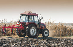 Tractor plowing field Royalty Free Stock Photo