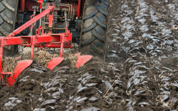 Tractor plowing field Stock Photo