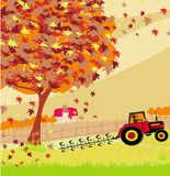 Tractor plowing field in autumn Stock Photo