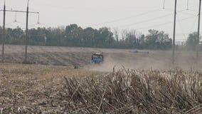 Tractor plowing field stock video