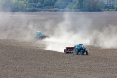 Tractor plowing the field. Stock Photos