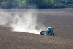 Tractor plowing the field. Royalty Free Stock Photo