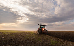 Tractor plowing a field Royalty Free Stock Photos