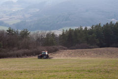 Tractor plowing the field Royalty Free Stock Photos