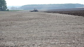 Tractor plowing in the field. stock video footage