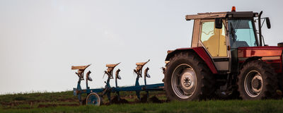 Tractor plowing a field Royalty Free Stock Image