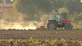 Tractor plowing stock video