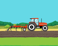 Tractor plowing a field Stock Image