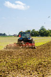 Tractor Plowing field Royalty Free Stock Images