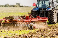 Tractor Plowing field Royalty Free Stock Image