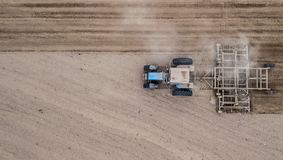 Tractor plowing field from right to left top view. Agriculture. Tillage stock image