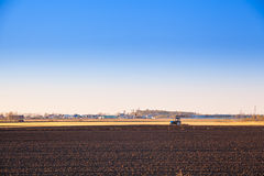 Tractor plowing a field for spring planting Stock Images