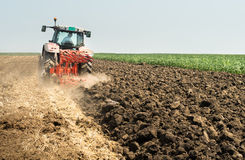 Tractor plowing field Stock Photos