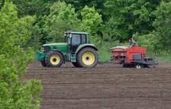 Tractor plowing a field Stock Photography