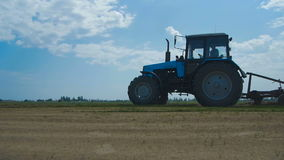 Tractor Plowing In The Field stock footage
