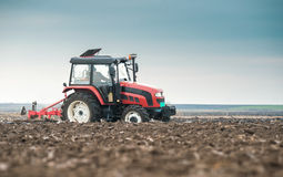 Tractor plowing field Stock Image