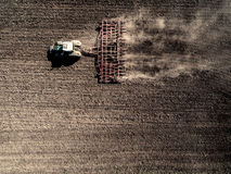 Tractor plowing field, top view Stock Photography