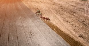 Tractor plowing field top view, aerial photography with drone. Tractor plowing field top view, aerial photography with drone stock image