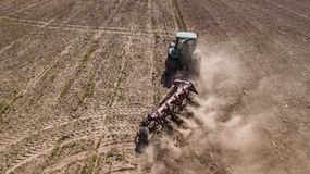 Tractor plowing field top view, aerial photography with drone. Tractor plowing field top view, aerial photography with drone stock photos