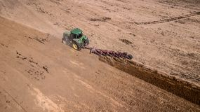 Tractor plowing field top view, aerial photography with drone. Tractor plowing field top view, aerial photography with drone royalty free stock photos