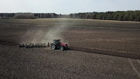 Tractor plowing field, view from the drone stock footage
