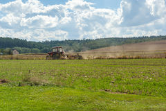 Tractor plowing in field. Stock Image